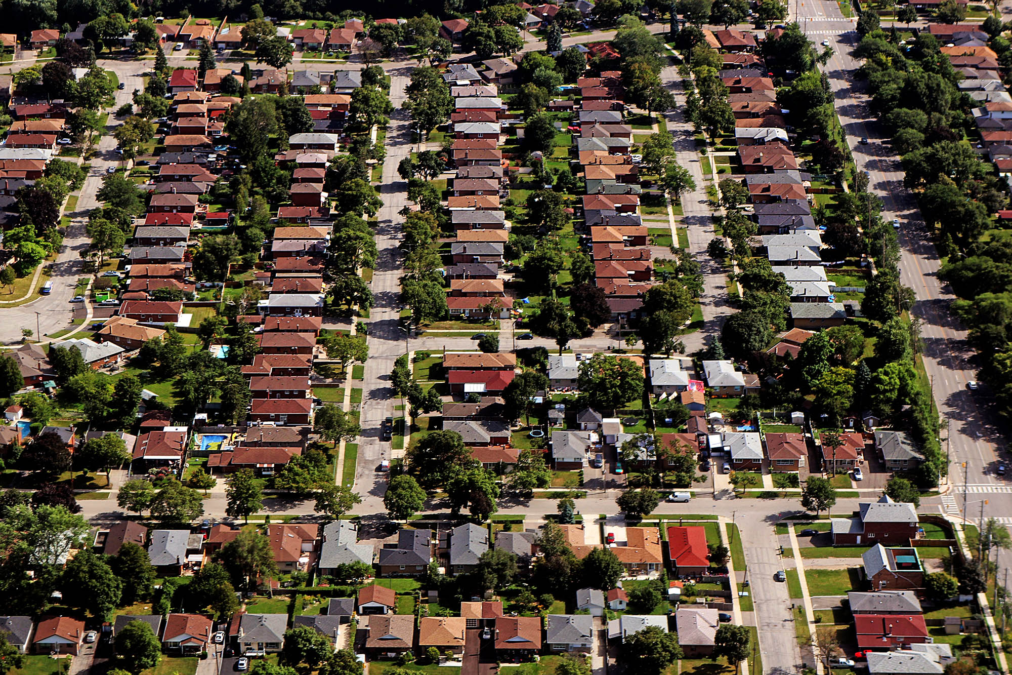 Arial view of house rooftops and city blocks near Toronto and su